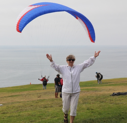 Mom after successful tandem paragliding flight